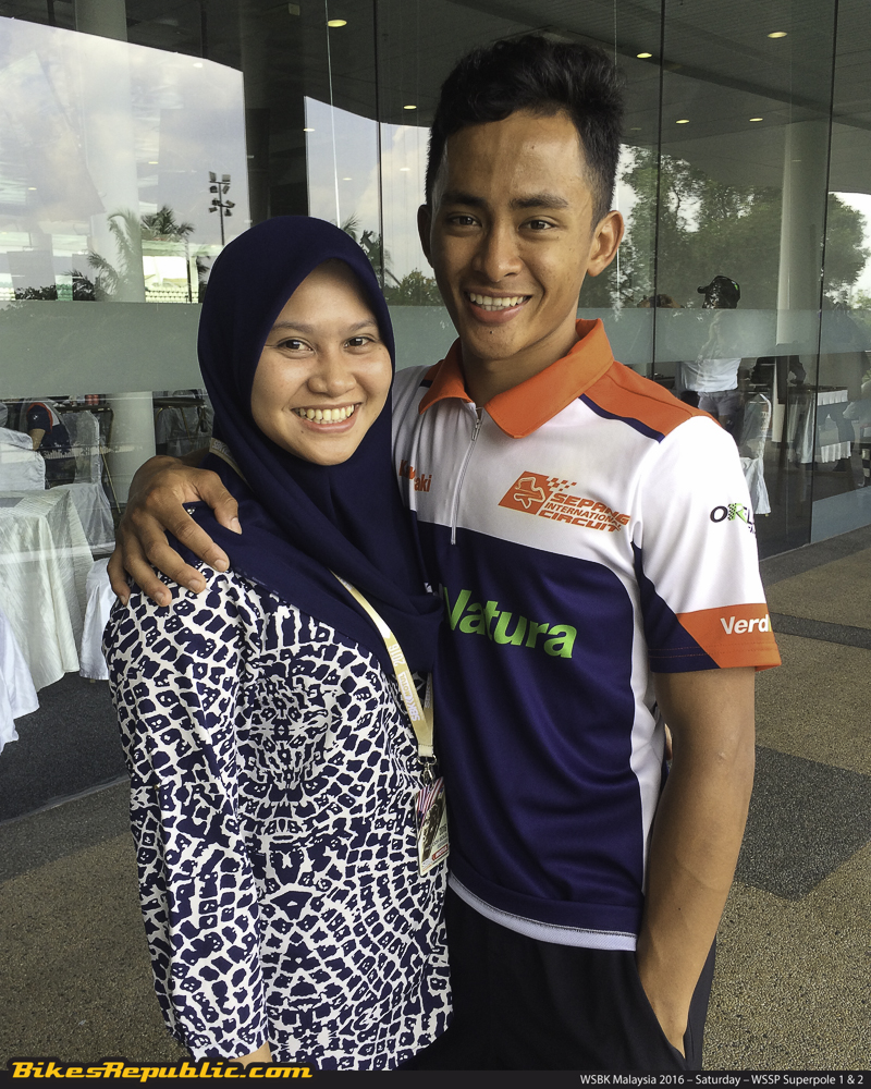 Fahmi and his wife in the circuit paddock earlier today.