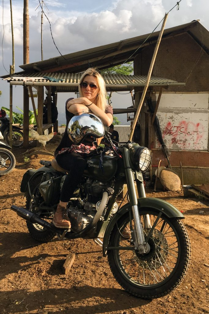 Mia astride a Royal Enfield Bullet 500 whilst riding across Indonesia recently.