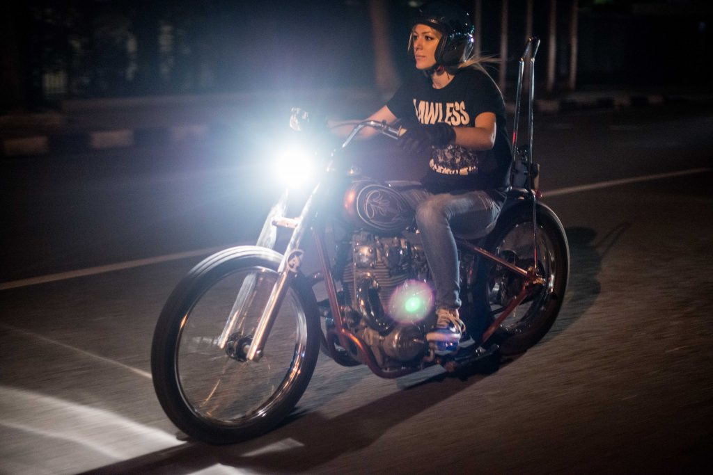 Mia enjoying a night ride with her prized 1998 H-D Roadsrer Rigid (Photo Credit: @sam.bin)