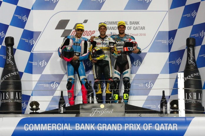 Lüthi (centre) winning the season-opener Qatar race this year.