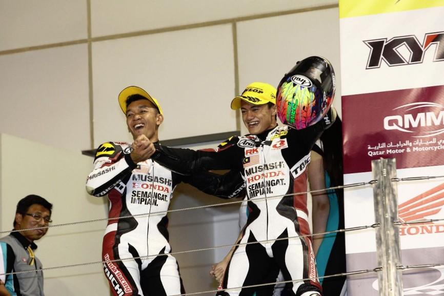 Zaqhwan Zaidi and Zamri Baba celebrating their success in the 2014 ARRC season finale in Qatar